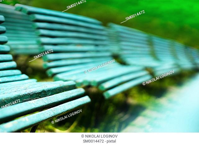 Diagonal park benches bokeh background hd