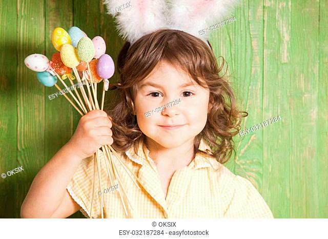 Girl with bunny ears and little eggs. Easter celebration