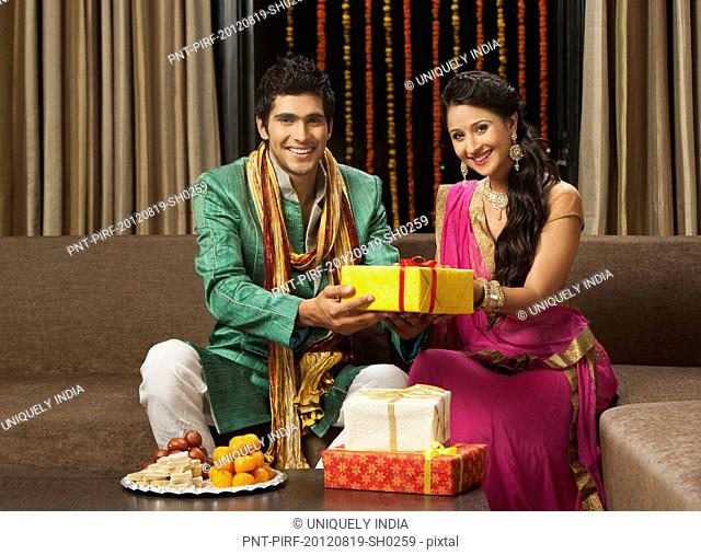 Man giving gift to his girlfriend on Diwali