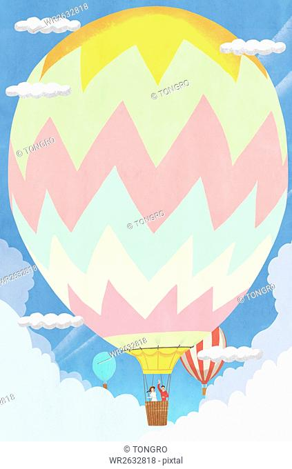 Background of spring with couple riding in air-hot balloon