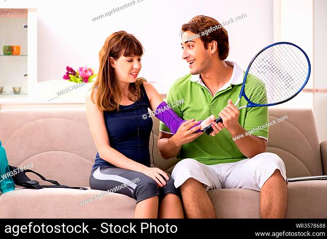 Man and woman discussing elbow strap