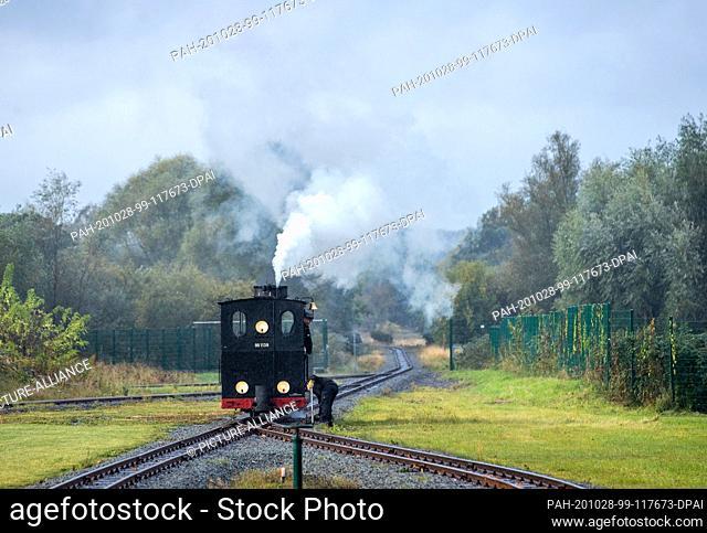 17 October 2020, Mecklenburg-Western Pomerania, Klütz: The 102-year-old brigade locomotive. The locomotive will pull the passenger train on the small railway...