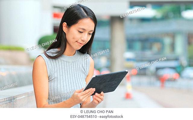 Woman looking at tablet computer