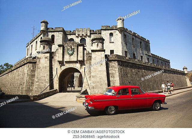 Old American car used as taxi in front of the Castillo De La Real Fuerza-Castle in Old Havana, La Habana, Cuba, West Indies, Central America