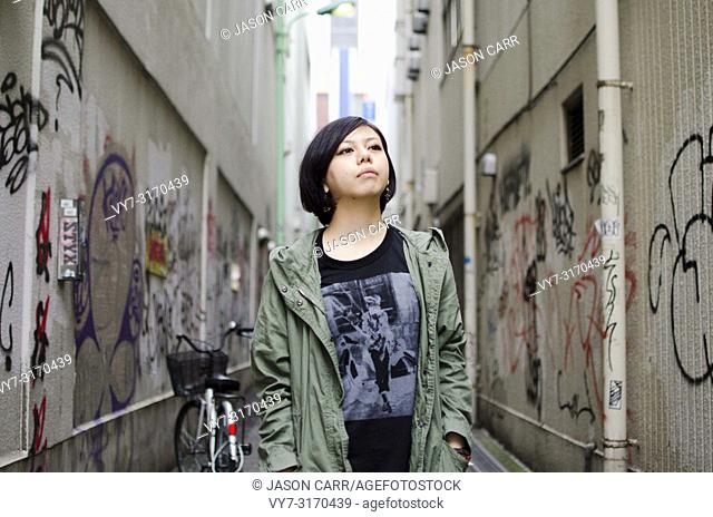 Japanese Girl poses on the street in Machida, Japan. Machida is an area located in Tokyo