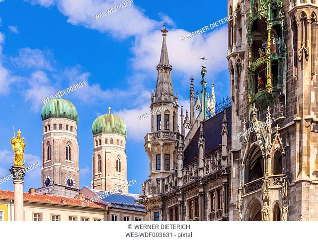 Germany, Munich, view of Marian column, spires of Cathedral of Our Lady and new city hall