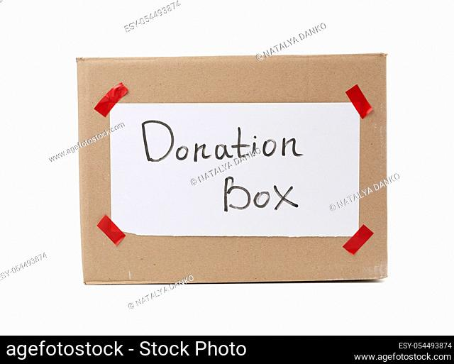 brown cardboard box with a pasted white sheet and the inscription donation box on a white background, help concept