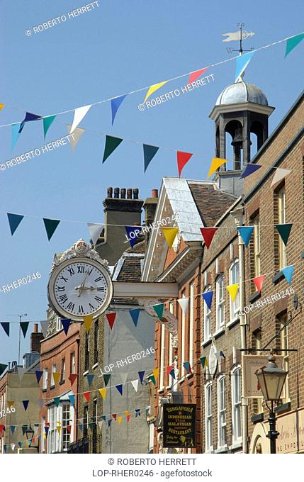 England, Kent, Rochester, View along Rochester High Street with coloured flags marking the Dickens Festival