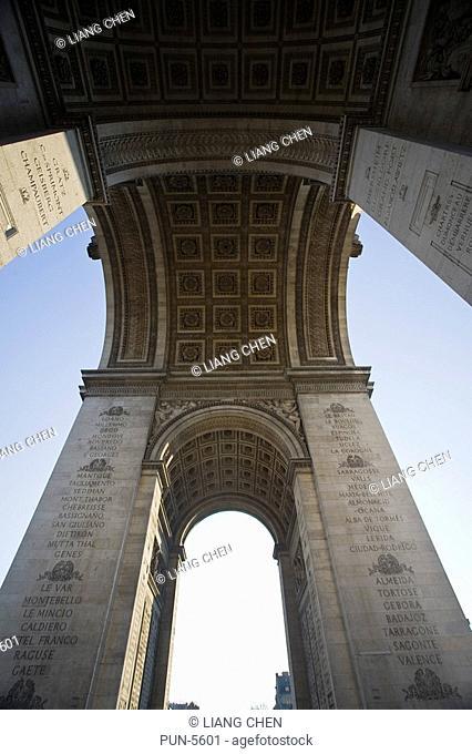 A low angle view of the Arc de Triomphe de I'Etoile