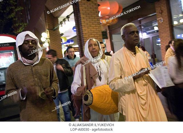 Followers of Hare Krishna singing their mantra. In the 1960's an elderly monk spread the Krishna mantra and beliefs around the Western world thus making Hare...