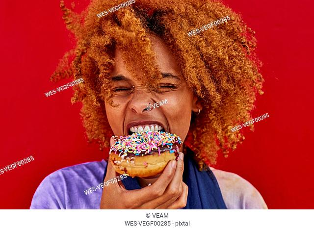 Portrait of woman eating a donut