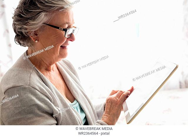 Senior woman looking at her tablet