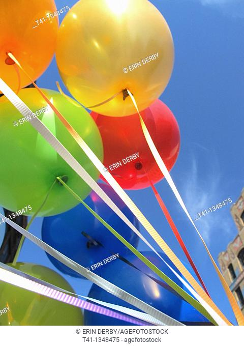 A bunch of birthday balloons in an urban setting, Brooklyn, NY