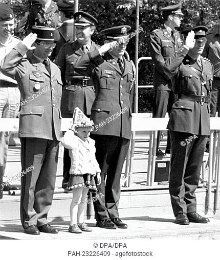 A small girl 'smuggled' herself among the officers of the allied defensive forces on the VIP stand during a military parade on occasion of the 'Armed Forces...