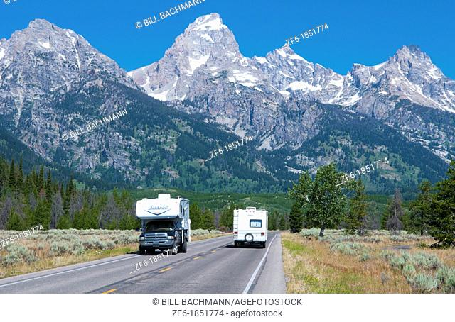 Jackson Hole Wyoming with the beautiful Grand Tetons mountain range and road with RVs driving