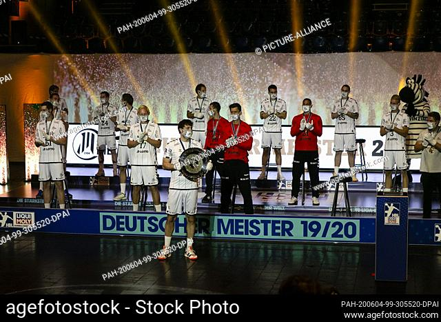 04 June 2020, Schleswig-Holstein, Kiel: The players of THW Kiel are standing on a podium after being honoured as German handball champions with distance and...