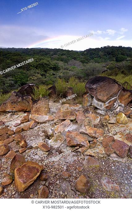 Thermal mud pot with rainbow in the background at Parque Nacional Volcano Rinc—n de la Vieja in Guanacaste, Costa Rica