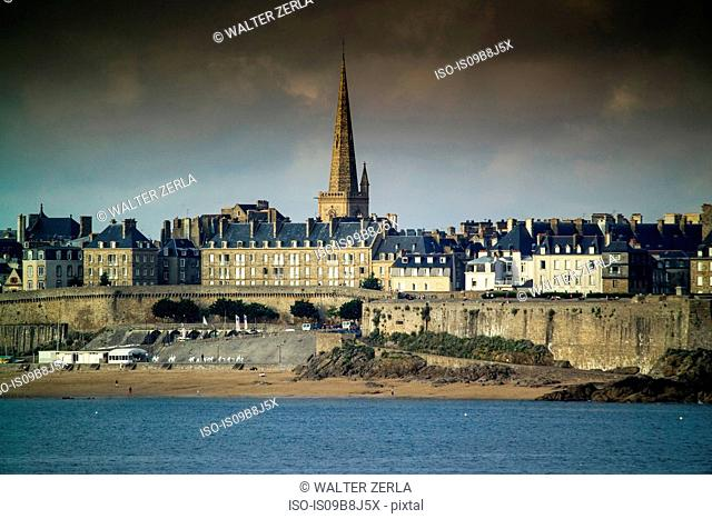 Waterfront view of beach townhouses and skyline, Saint-Malo, Brittany, France