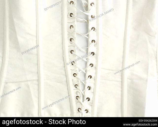 fragment of a white satin corset with lacing, wrong side of clothes