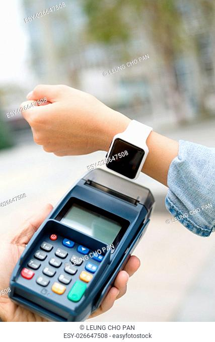 Female pay by smart watch