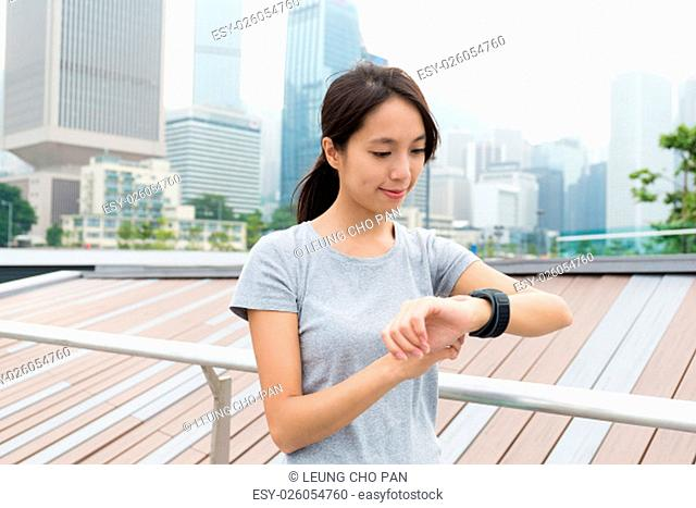 Woman touch on her wearable watch