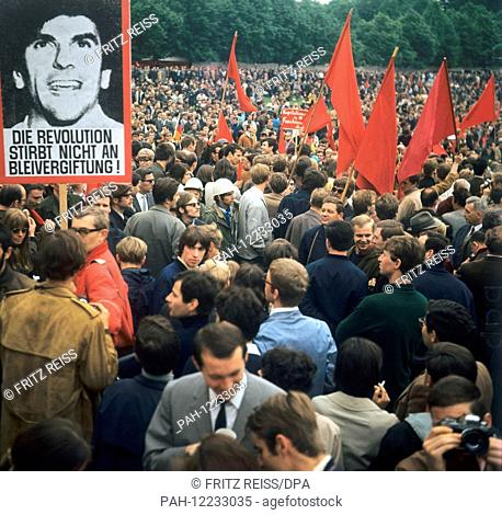 Students holding red flags protest on 20 May 1968 against the German Emergency Acts. On left a poster of students spokesperson Rudi Dutschke