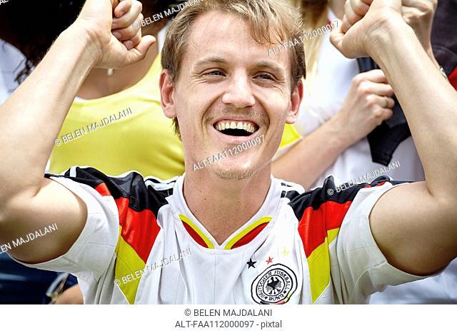 German football fan cheering at match