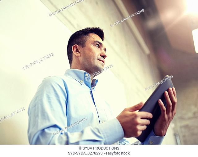 teacher or lector with tablet pc at lecture