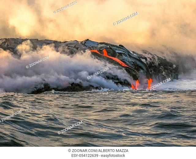 Volcanic activity with smoke and steam given off by lava contact with Pacific Ocean. Kilauea Volcano in Hawaii Volcanoes National Park, Big Island