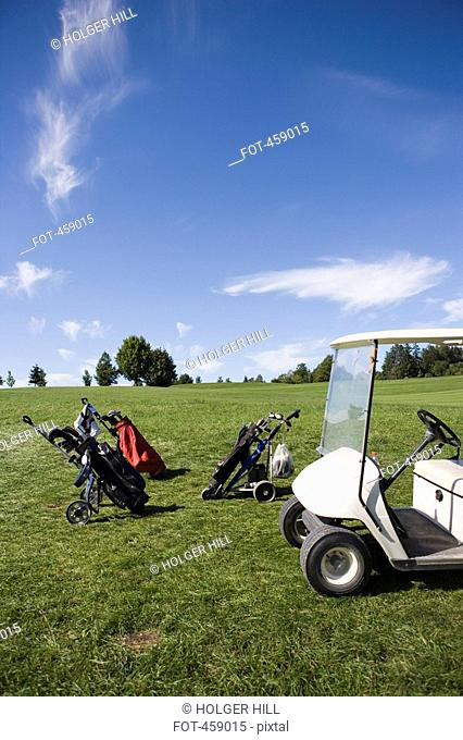 Golf bags and a golf cart