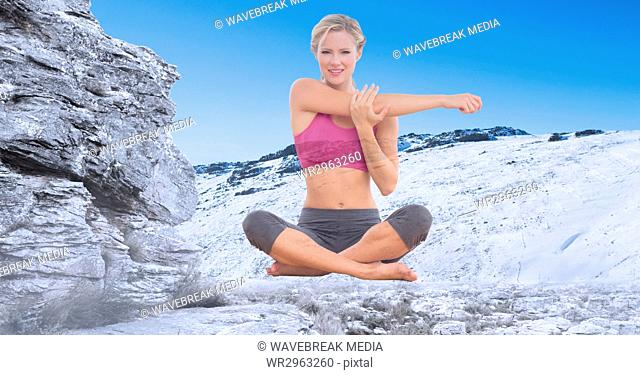 Double exposure of woman exercising on snowcapped mountain