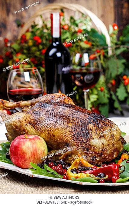 Roasted goose in autumn setting