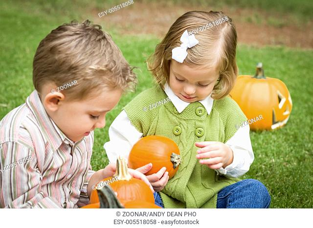 Cute Young Brother and Sister At the Pumpkin Patch