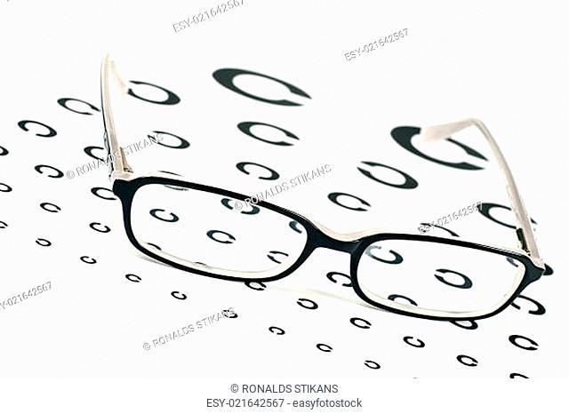 black glasses on a eye sight test chart