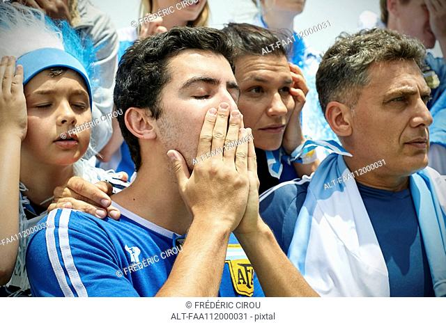 Argentinian football fans watching football match