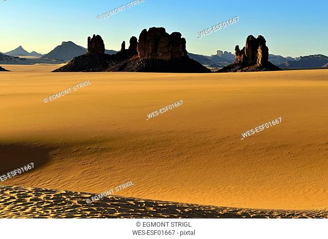 Africa, Algeria, Sahara, Tassili N'Ajjer National Park, Tadrart, Rock towers and sand dunes in Tiou Tatarene