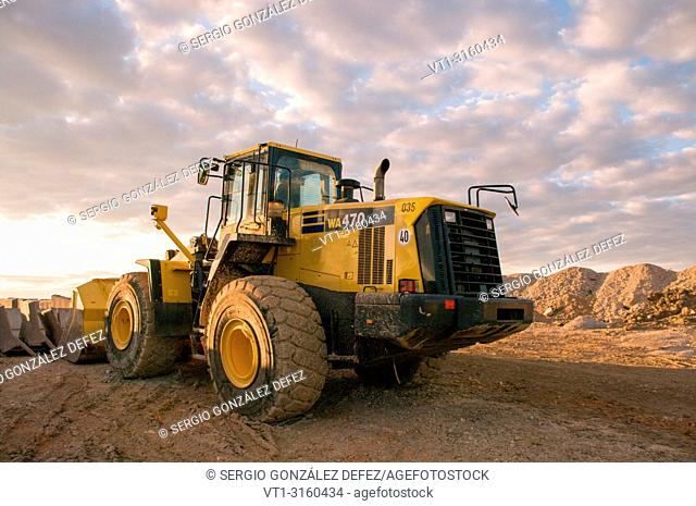 Machine of construction in a quarry of sand