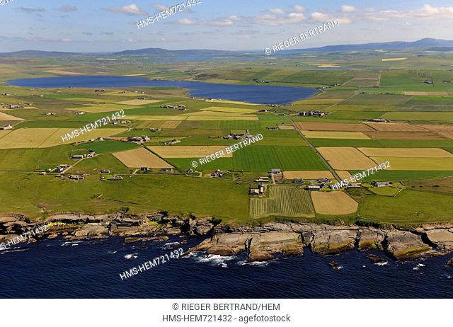 United Kingdom, Scotland, Orkney Islands, Isle of Mainland, fields and scattered farms by the sea at Birsay, the Loch of Boardhouse in the background aerial...