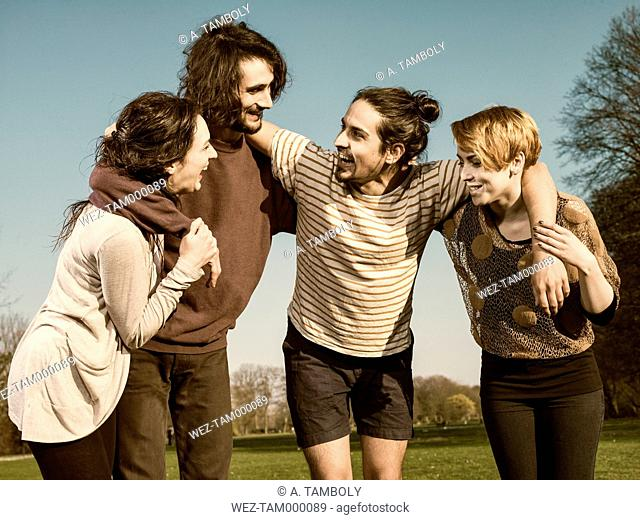 Group of four friends having fun