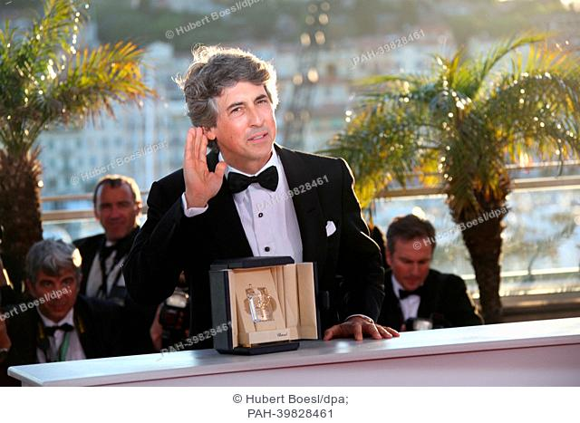 """Director Alexander Payne poses with the award for best actor winner Bruce Dern from Payne's movie """"""""Nebraska"""""""" at the Winner's Photo Call during the 66th Cannes..."""