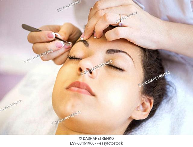 Portrait of a beautiful young woman in cosmetic salon. Close up. Beauty treatments