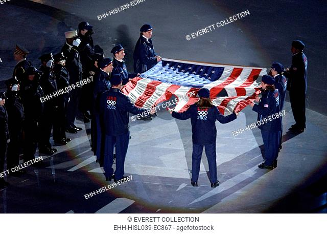 The US Olympic Team holds the American flag that flew over the Ground Zero on Sept. 11, 2001. Firefighters took the flag from a boat docked in the yacht basin...