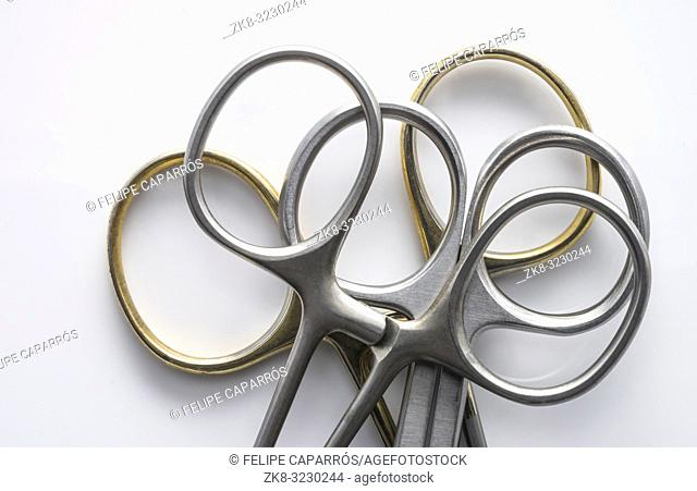 Various metal scissors isolated on white background, conceptual image