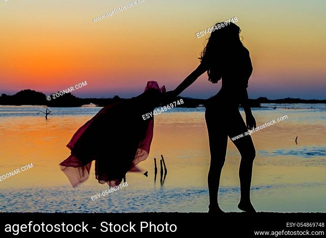 A beautiful hispanic brunette model enjoying the morning sun at sunrise