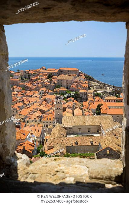 Dubrovnik, Dubrovnik-Neretva County, Croatia. View over rooftops of the old town from the Minceta Tower. Boats in the Old Port. Cruise boats under way