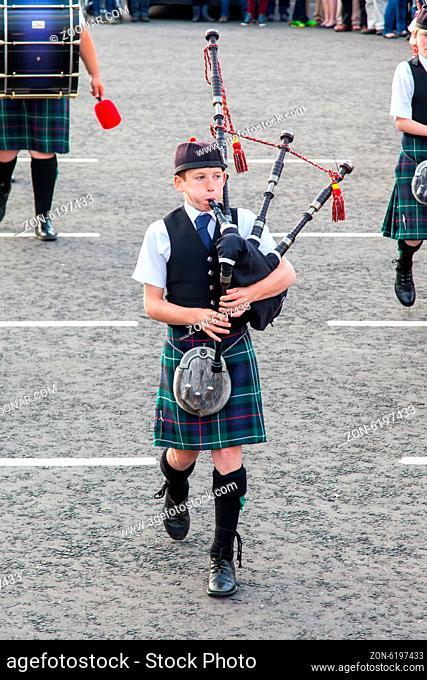 ULLAPOOL, SCOTLAND - JULY 17: Bagpipes' parade at local Highland Games on july 17, 2014 in Ullapool, Scotland