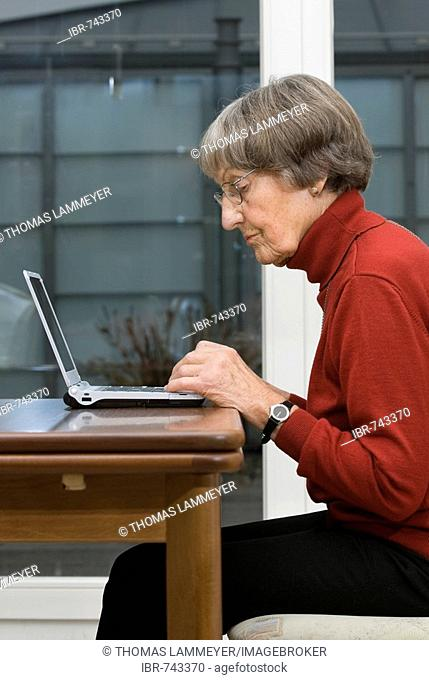 Active pensioner working on laptop
