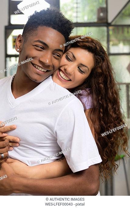 Happy young woman in love hugging her boyfriend