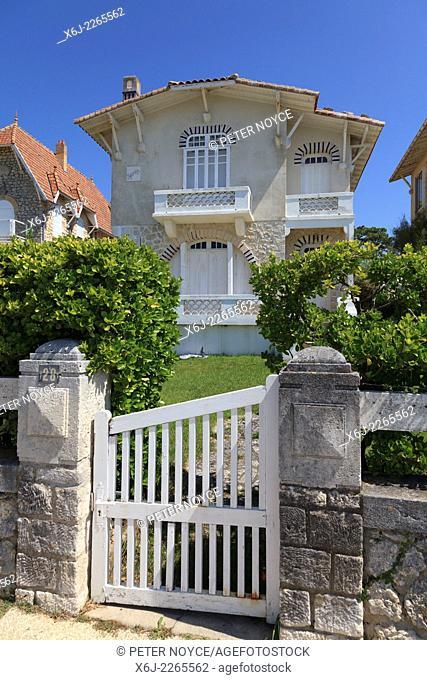 White gate entrance to traditional French seaside house on the Corniche de Nauzan near Royan