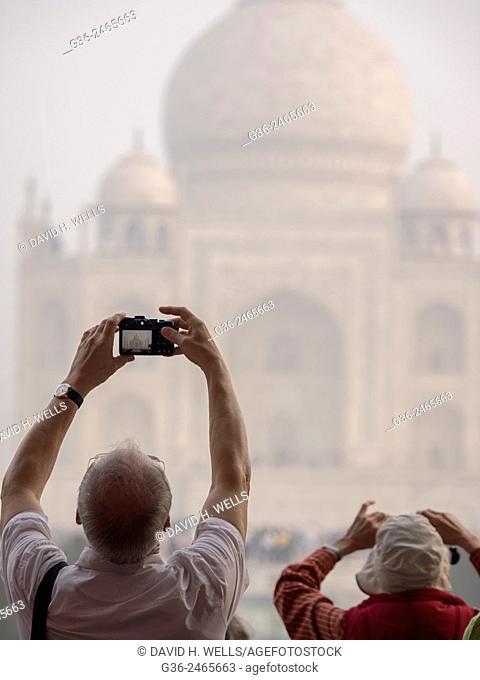 Person photographing Taj Mahal using mobile camera, Agra, Uttar Pradesh, India